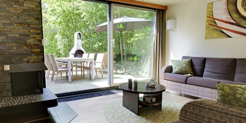 Center Parcs cottages met privébuitensauna en badkamer met bubbelbad